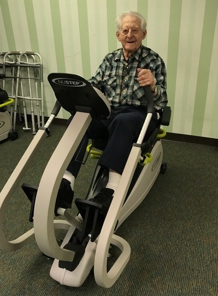 Resident using a lower body equipment